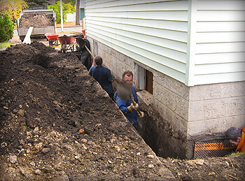 Kevin Kuypers digging around a home in Edmonton, AB